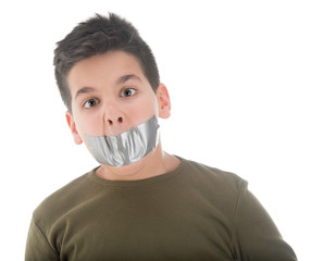 Ten year old child with silver tape over his mouth isolated