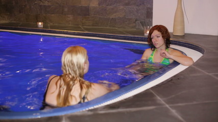 Friends relaxing in wellness and Spa swimming pool