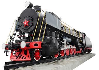 Паровоз стоит на постаменте. Железнодорожный транспорт. Ретро.