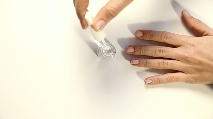 Woman polish her nail on table