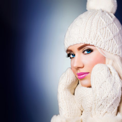 Beautiful blonde girl in winter hat
