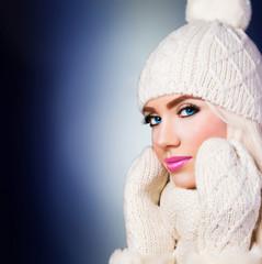 Beautiful blonde girl in winter hat