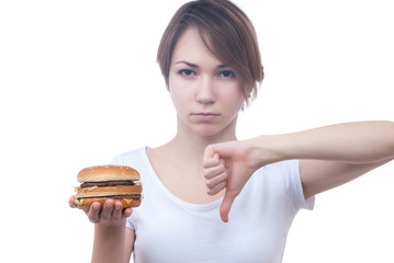 Portrait of girl with humburger showing thumb down