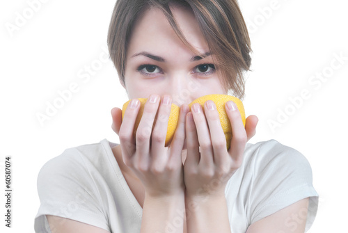 Girl sniffing two parts of lemon