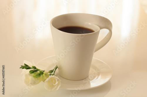 black coffee in a mug on a saucer