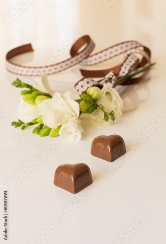 sprig of freesia flower and chocolates