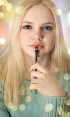girl paints lips
