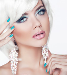 Blond girl. Jewelry. Makeup. Fashion Beauty Woman Portrait with