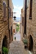 Medieval stepped street in the Italian hill town of Assisi - 60590863