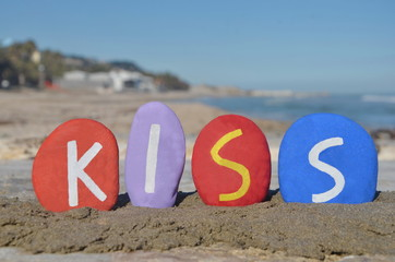 Kiss word on colourful stones