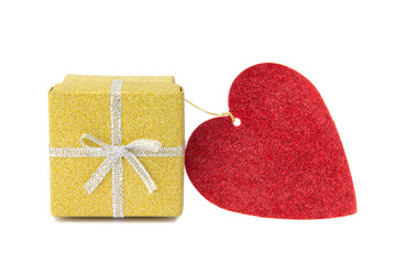 Golden gift box and red heart shaped card