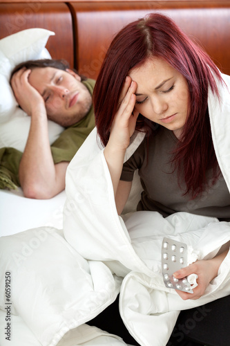 Man and woman with migraine