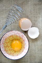 fresh egg with whisk