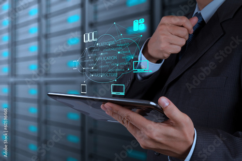 Leinwanddruck Bild Businessman working with a Cloud Computing diagram on the new co