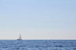 Sailboat alone at open sea
