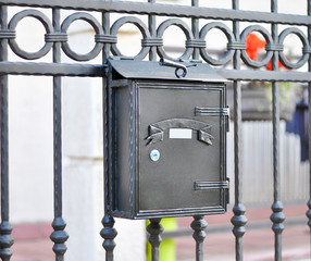 Metallic mailbox on gate