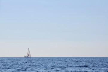 Sailboat alone at open sea