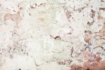 Old grunge wall with cracked stucco. Background texture