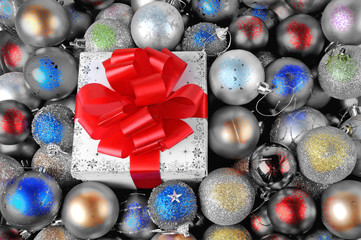 Colorful Christmas baubles with gift box