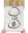 hand pull crumpled paper show dollar sign bag out of recycle env