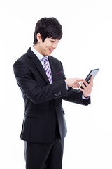 Young Asian business man using a pad PC