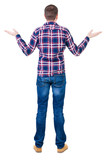 Back view of angry young man in jeans and checkered shirt