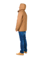 Back view of handsome man in winter jacket  looking up.