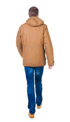 Back view of going  handsome man in brown parka.