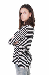 side view of standing young beautiful  brunette woman in striped