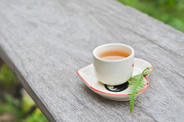 white cup of hot tea on table