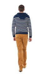 Back view of going  handsome man in jeans and striped sweater.