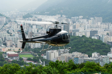 Excursion helicopter taking off and Botafogo in Rio de Janeiro