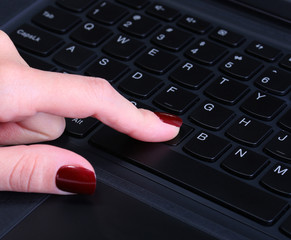 Female hand using computer keyboard
