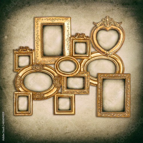 antique golden frames over grungy wall background