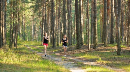 Two woman Jogging in forest