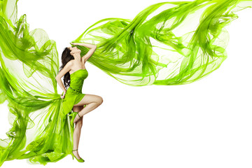Woman dancing in green dress, fluttering waving fabric