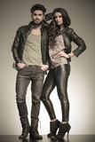 in love couple dressed in leather clothes