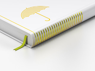 Protection concept: closed book, Umbrella on white background