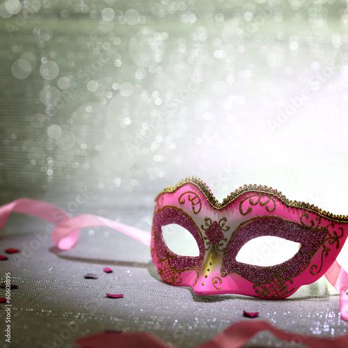 Fotobehang Carnaval Pink carnival mask with glittering background