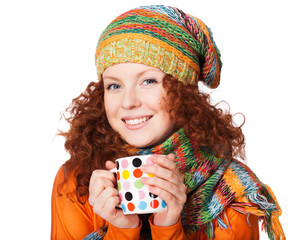 Beautiful young winter woman with cup