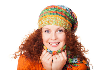 Smiling redhead girl in warm clothing