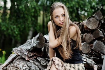 The resting young girl in the woods. Long hair dispelled by wind