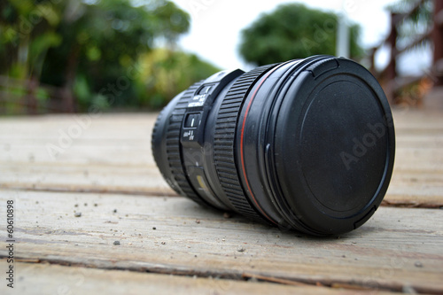 Camera lens on the wood floor