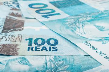 A hundred reais bills (brazilian money)