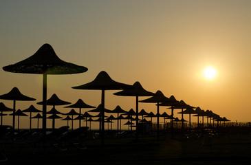 Silhouettes of beach's umbrellas