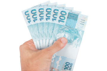 male hand holding brazilian six hundred reais, brazil money