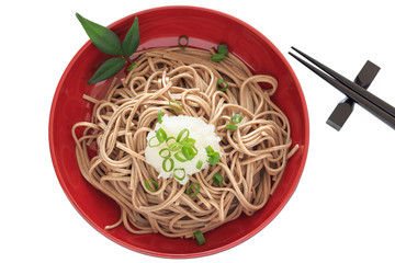 Buckwheat noodles with  grated radish on the white background
