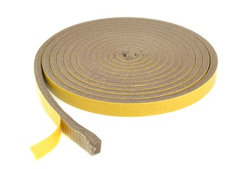 A roll of self adhesive draft exclusion insulation foam band