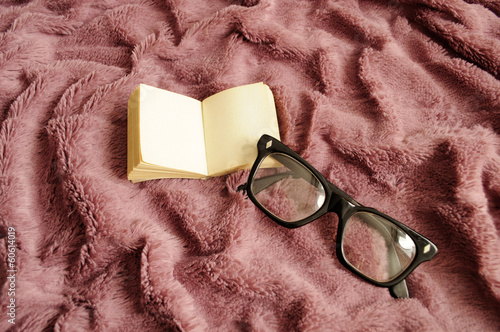 Tiny book and nerdy eyeglasses