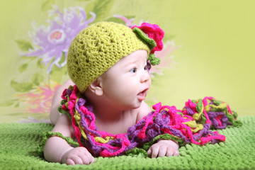 baby girl in a coquettish hat